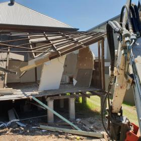 Demolishing part of 17 Stafford street, East Brisbane.